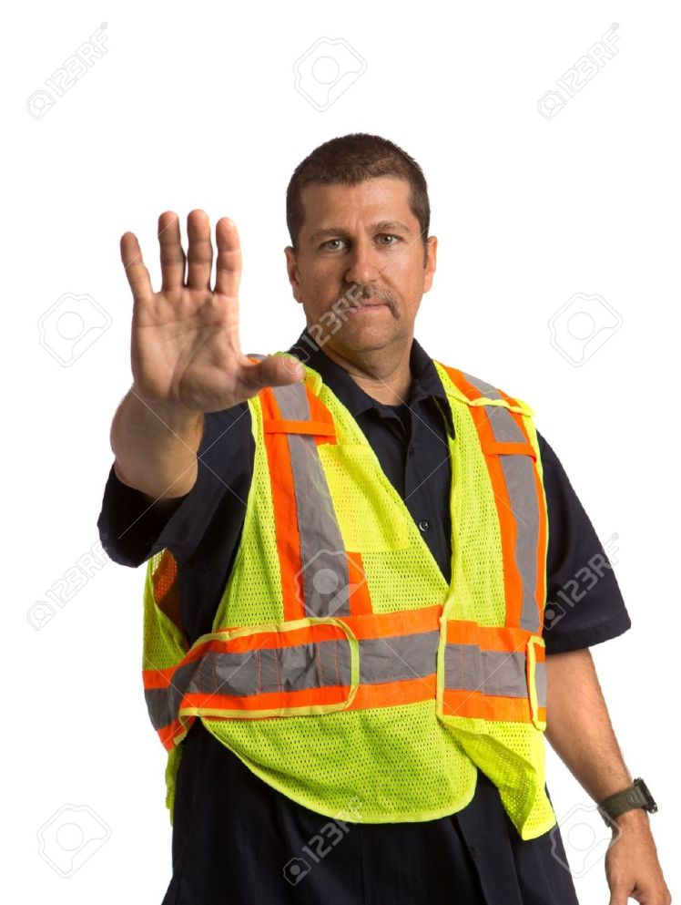 14902909-security-officer-wearing-safty-vest-hand-gesture-directing-traffic-on-isolated-background-stock-photo
